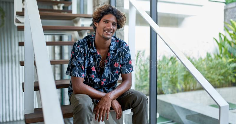 Attractive brazilian hipster millennial man looking into camera royalty free stock images