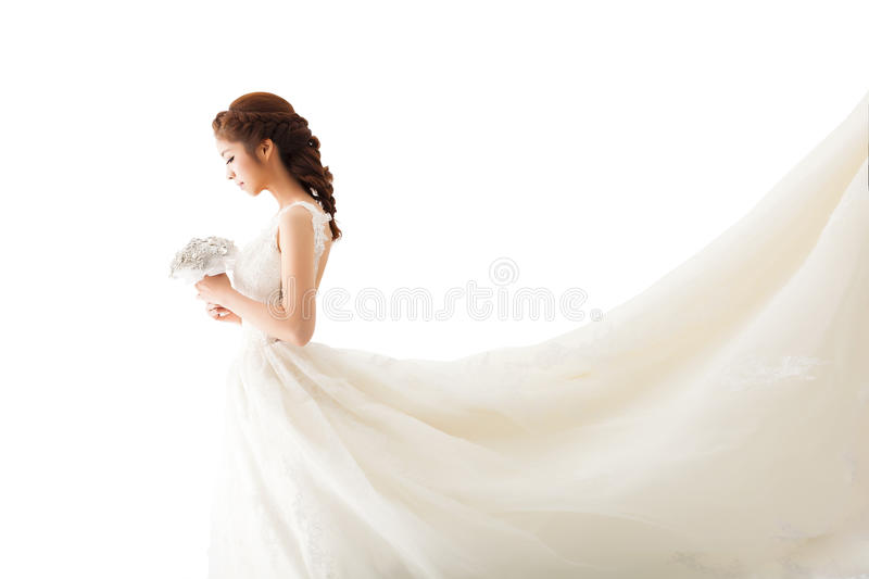 Attractive bride with flowers. Young attractive bride with flowers stock image