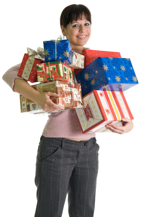 Attractive brunette with armful of X-mas presents. Young brunette with armful of Christmas presents isolated over white stock image