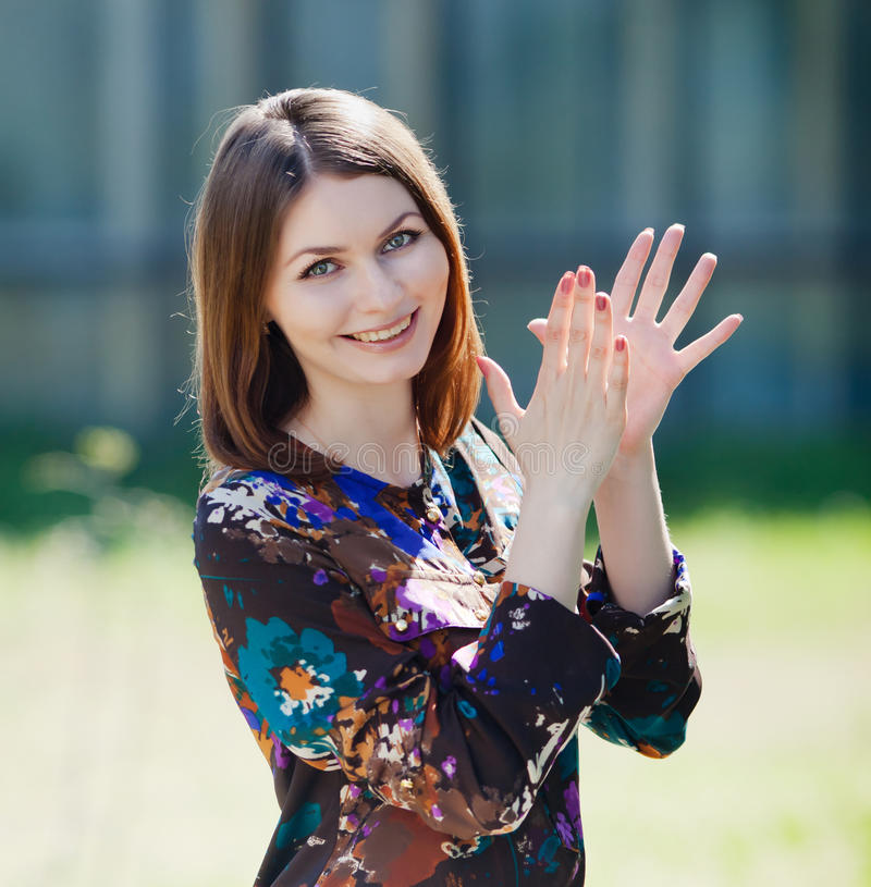 Attractive brunette in blouse outdoors royalty free stock photo