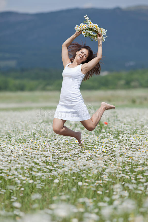 Attractive brunette in chamomile wreath royalty free stock photos