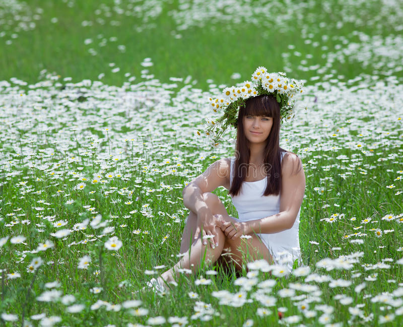 Attractive brunette in chamomile wreath stock photography