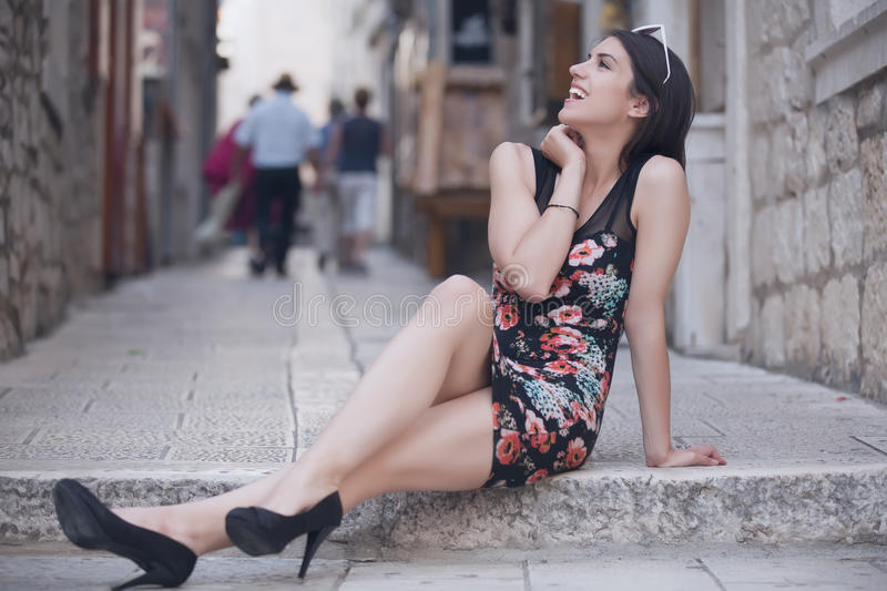 Attractive brunette elegant woman having fun enjoying summer,laughing and smiling happy during summer holiday vacation travel.Wome stock photos