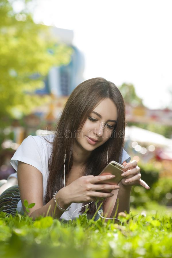 Attractive Brunette Female in Park Outdoors. stock photography