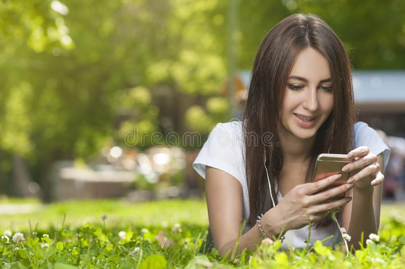 Attractive Brunette Female in Park Outdoors. stock image