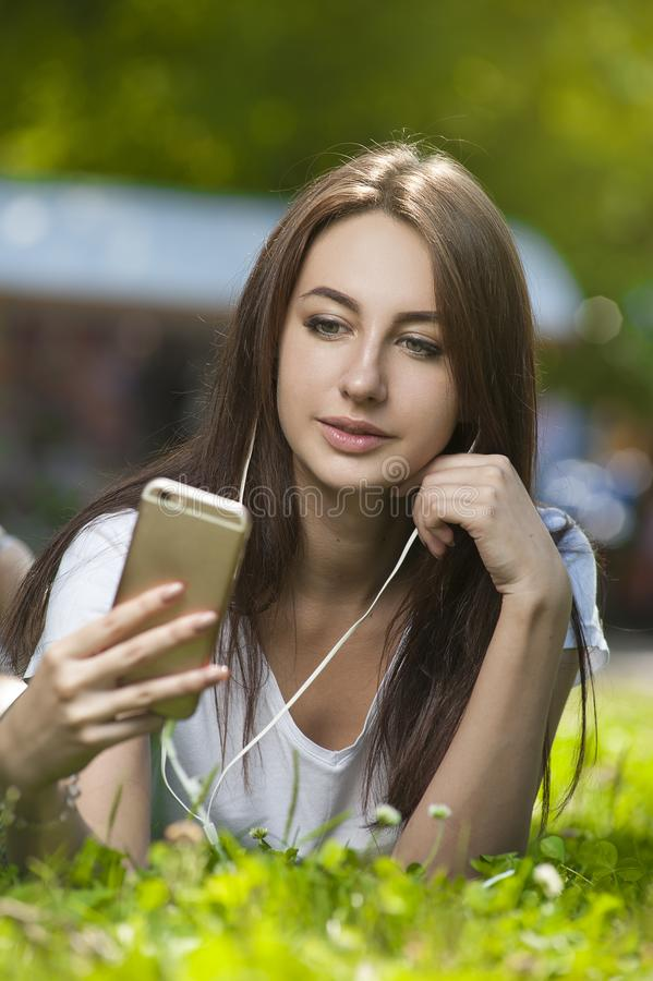 Attractive Brunette Female in Park Outdoors. royalty free stock image