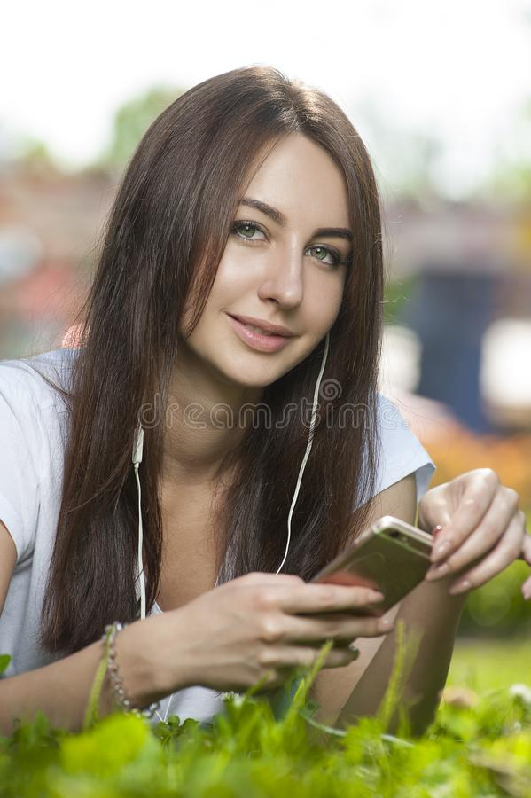 Attractive Brunette Female in Park Outdoors. royalty free stock photos