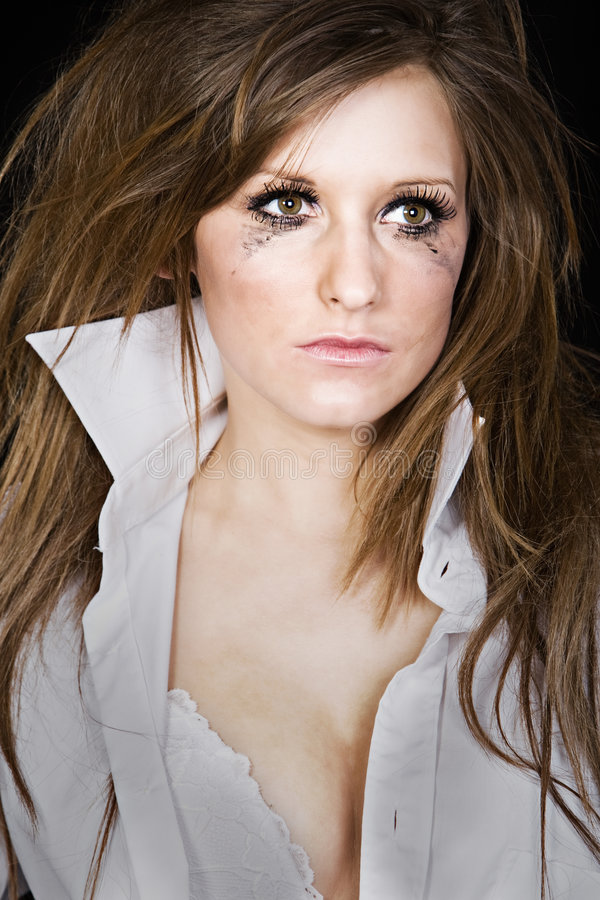 Attractive Brunette Girl with Messy Makeup. Shot of an Attractive Brunette Girl with Messy Makeup stock photo