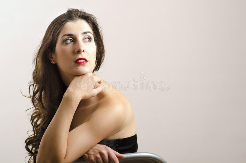 Attractive brunette girl in studio shot stock image
