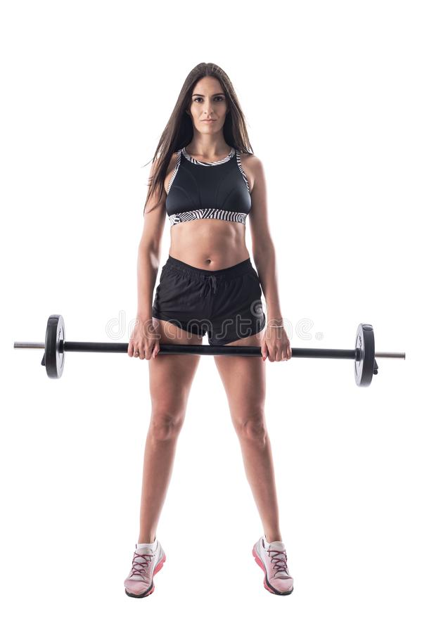 Attractive brunette gym girl confident sportswoman posing with barbell. stock photo
