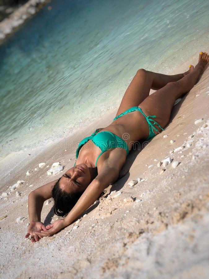 Attractive brunette posing at the beach. Attractive brunette posing at the seaside of Thassos island, Saliara beach, one of the famous marble beaches royalty free stock image