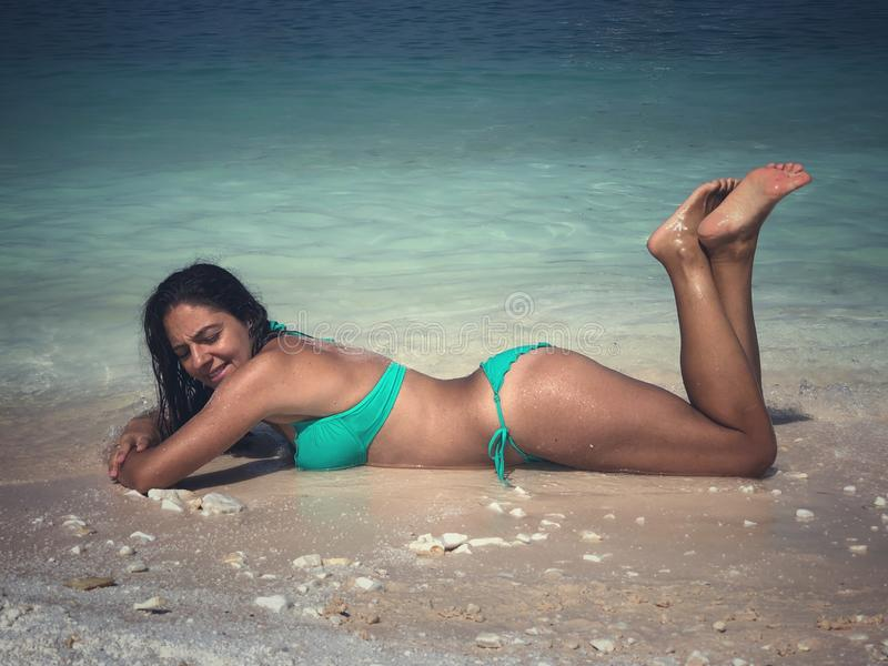 Attractive brunette posing at the beach. Attractive brunette posing at the seaside of Thassos island, Saliara beach, one of the famous marble beaches stock photography