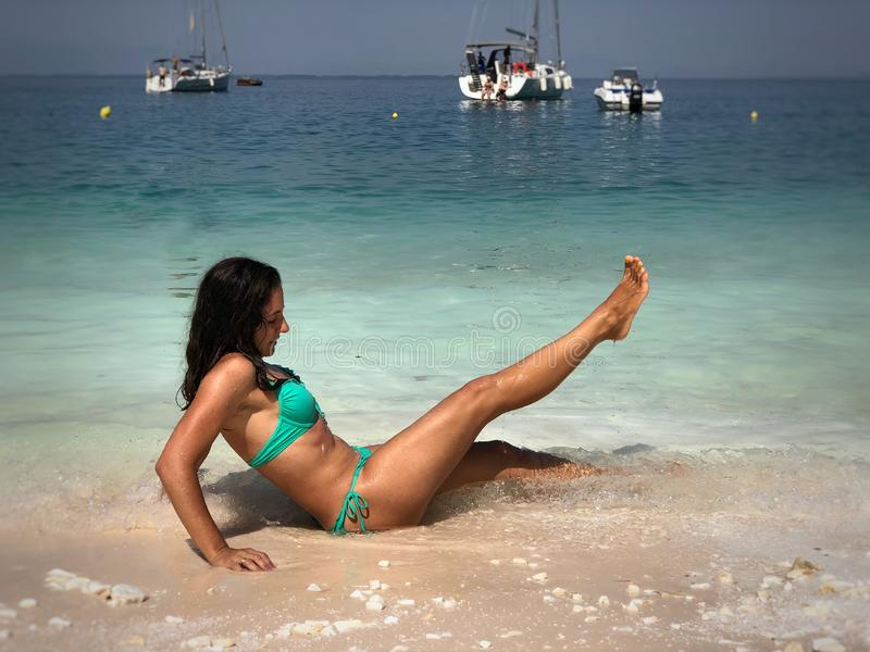 Attractive brunette posing at the beach. Attractive brunette posing at the seaside of Thassos island, Saliara beach, one of the famous marble beaches royalty free stock photography