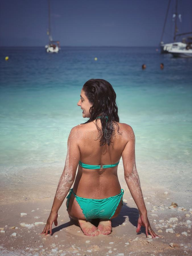 Attractive brunette posing at the beach. Attractive brunette posing at the seaside of Thassos island, Saliara beach, one of the famous marble beaches royalty free stock photo