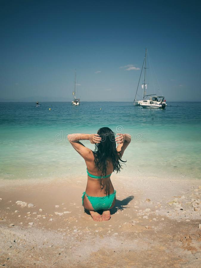 Attractive brunette posing at the beach. Attractive brunette posing at the seaside of Thassos island, Saliara beach, one of the famous marble beaches stock photo
