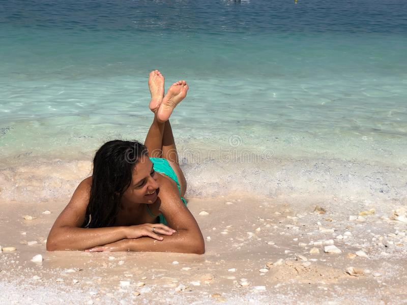 Attractive brunette posing at the beach. Attractive brunette posing at the seaside of Thassos island, Saliara beach, one of the famous marble beaches royalty free stock photos