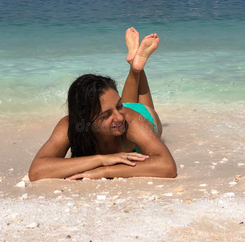 Attractive brunette posing at the beach. Attractive brunette posing at the seaside of Thassos island, Saliara beach, one of the famous marble beaches stock images
