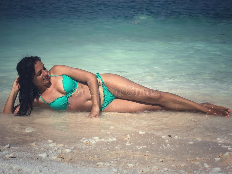 Attractive brunette posing at the beach. Attractive brunette posing at the seaside of Thassos island, Saliara beach, one of the famous marble beaches stock photos
