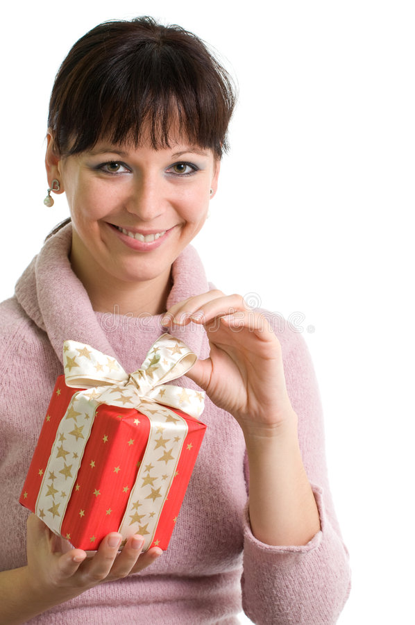 Attractive brunette with red Christmas present. Young smiling brunette holding red Christmas present isolated over white royalty free stock photography
