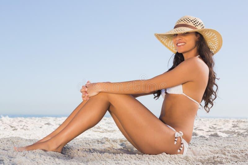 Download Attractive Brunette In White Bikini Posing While Sitting Stock Image - Image: 33215133