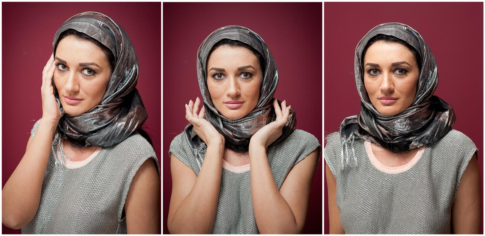 Attractive brunette woman in gray blouse and headscarf posing dramatic on purple background. Female art portrait, studio shot stock image