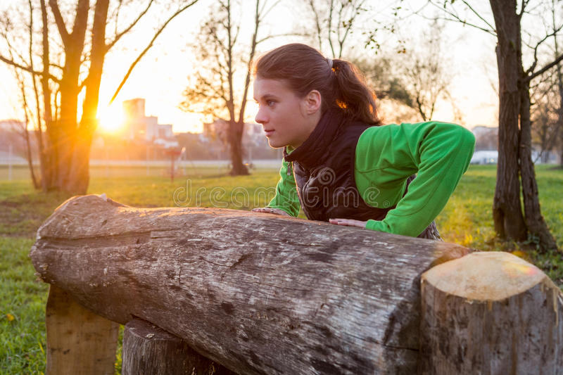 Attractive brunette working out in a park. stock photography