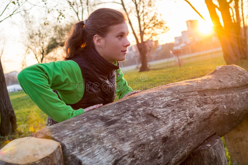 Attractive brunette working out in a park. royalty free stock images