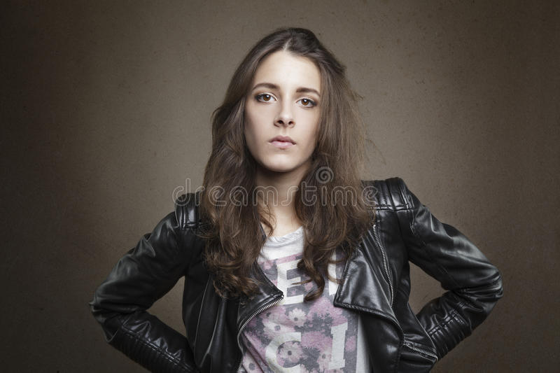 Attractive brunette young girl on textured warm background stock photo