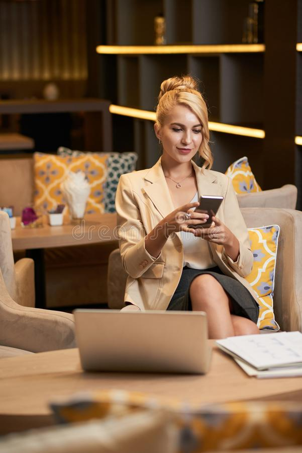 Attractive business lady in restaurant royalty free stock photography