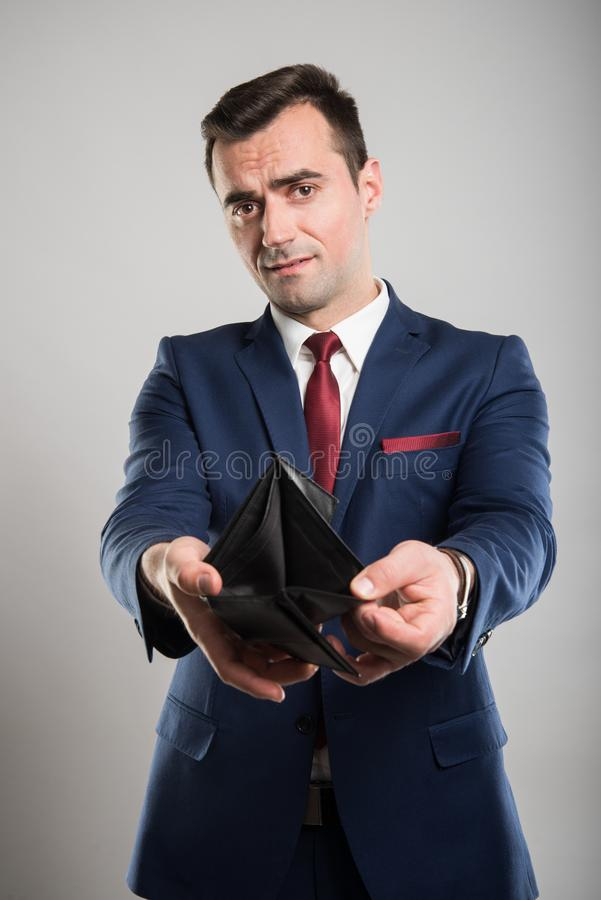 Attractive business man showing empty wallet stock photo