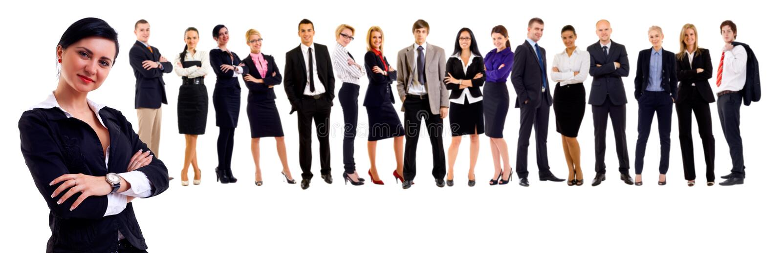 Attractive business people. Young attractive business people - the elite business team - lead by a business woman royalty free stock photos