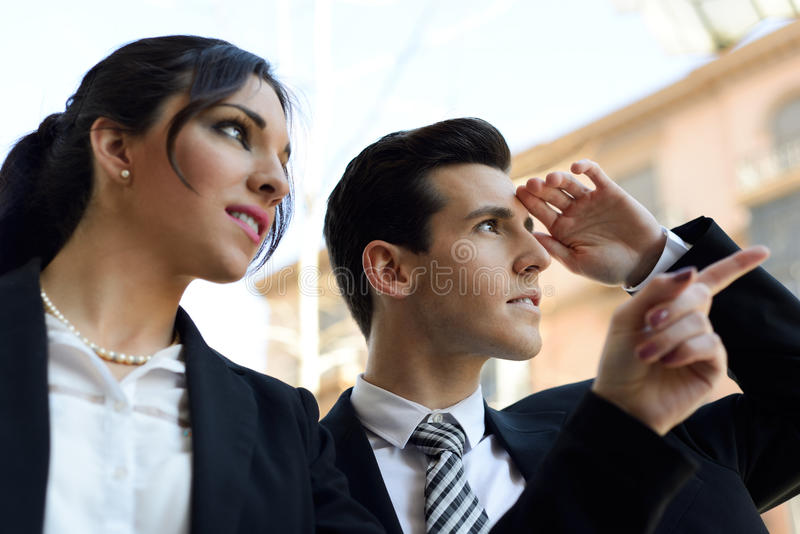 Attractive Business People Looking At Something