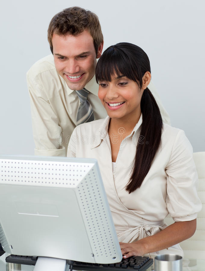 Attractive Business People In The Office Stock Photography