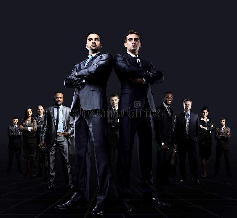 Attractive business people. Young attractive business people. on a black background stock photos