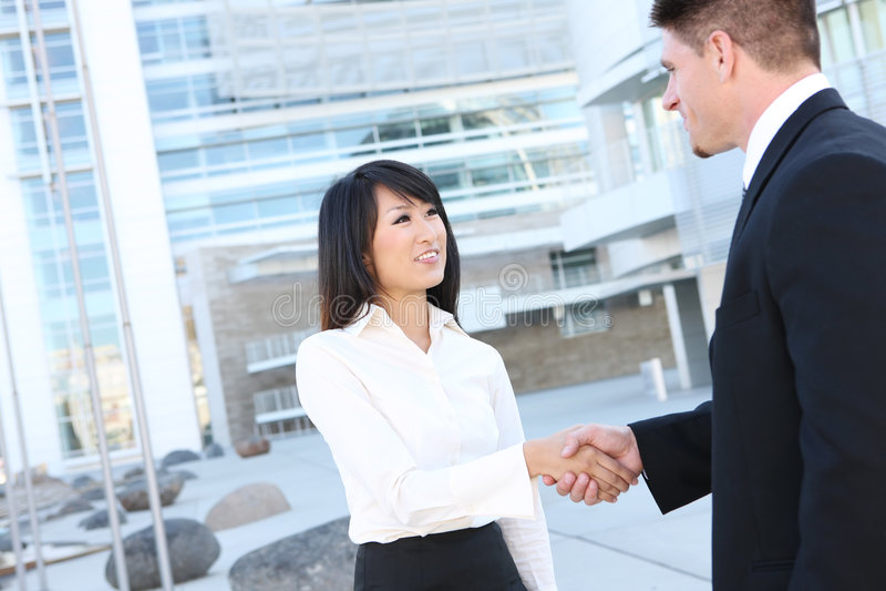 Attractive Business Team Handshake stock photos