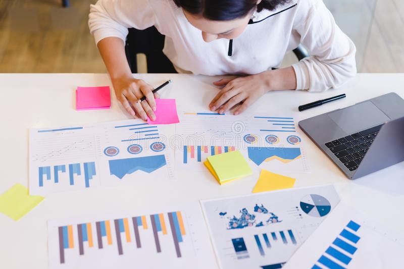 Attractive business woman analyzing brainstorming business reports. Business analysis and strategy concept stock images
