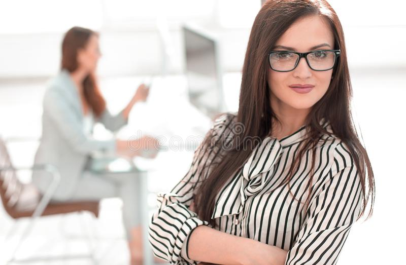 Attractive business woman on the background of the office stock photos