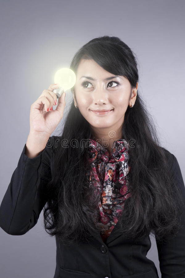 Download Attractive Business Woman Holding A Light Bulb Stock Image - Image of person, adult: 21792571