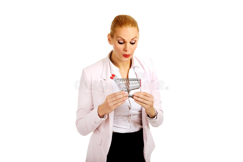Attractive business woman holding small trolley royalty free stock image