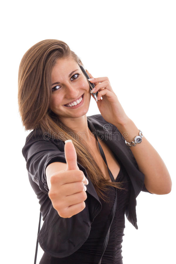 Attractive business woman with phone and thumbs up gesture royalty free stock photos