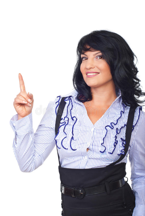 Attractive business woman pointing up stock photo