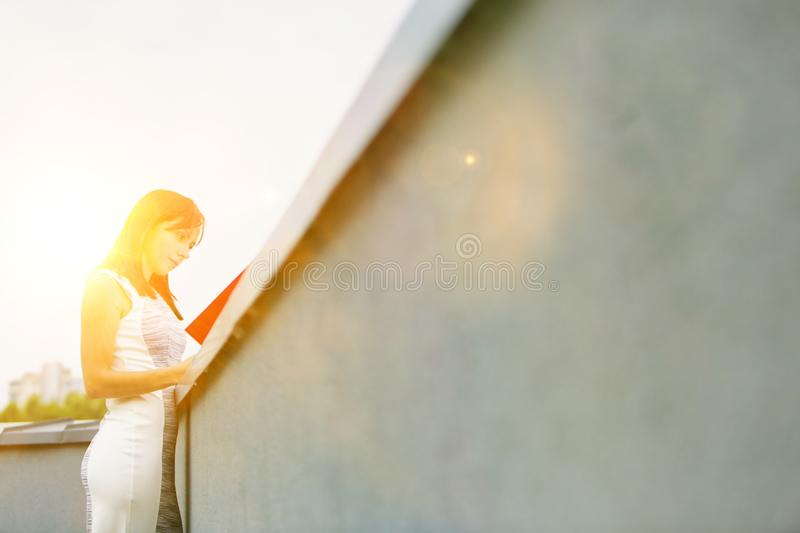 Attractive business woman reads  real file outside, concept moden women working in business royalty free stock photography