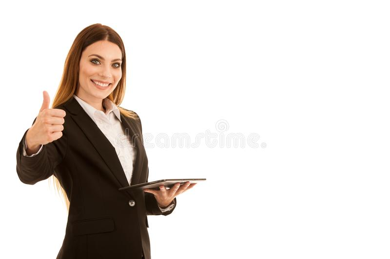 Attractive business woman showing thumb up as a gesture for success isolated over white background stock image