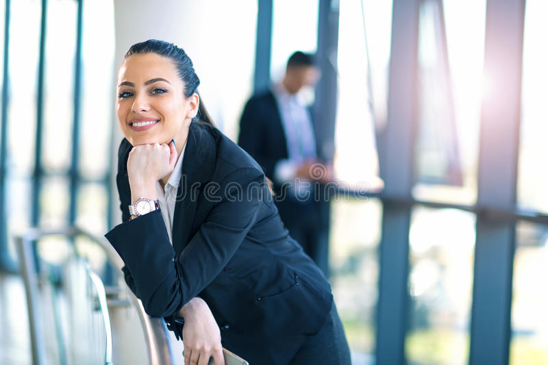 Attractive business woman standing in the hallway royalty free stock images