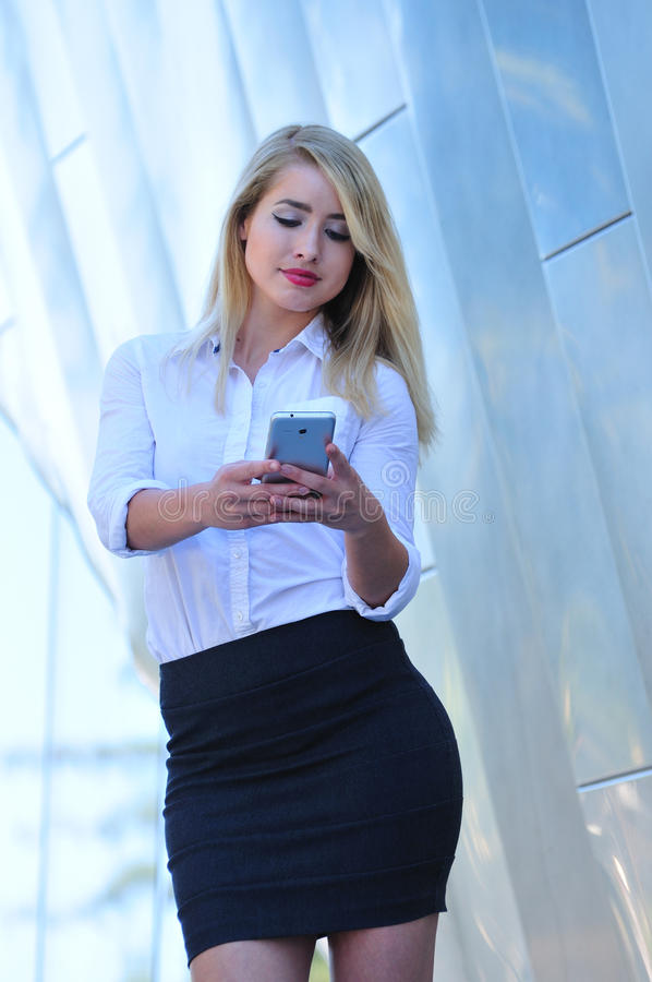 Attractive business woman taking photo with smart phone royalty free stock photos