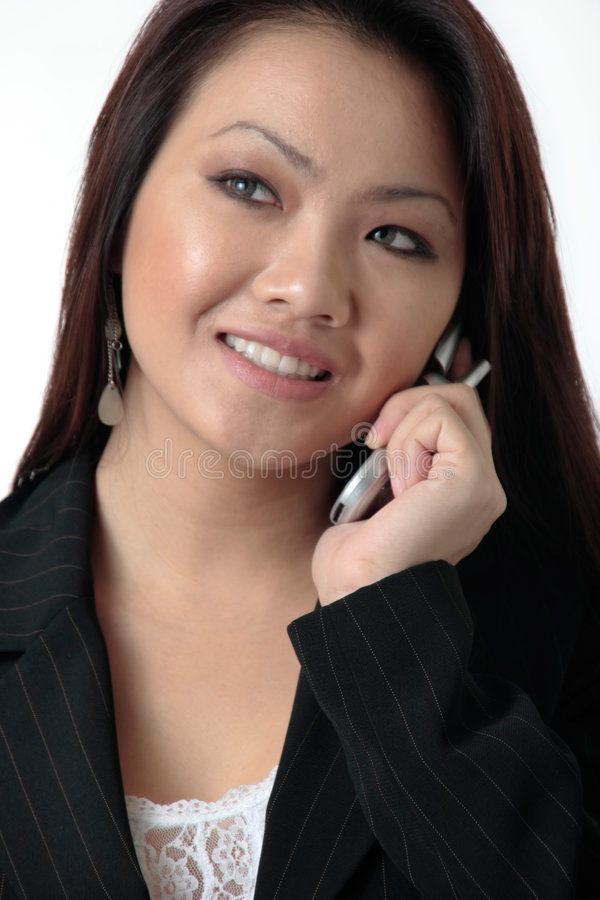 Attractive business woman talking on cell phone royalty free stock images