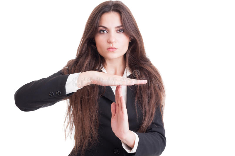 Attractive business woman or teacher showing time out gesture. Attractive business woman or teacher with long beautiful hair showing time out gesture isolated on stock photography