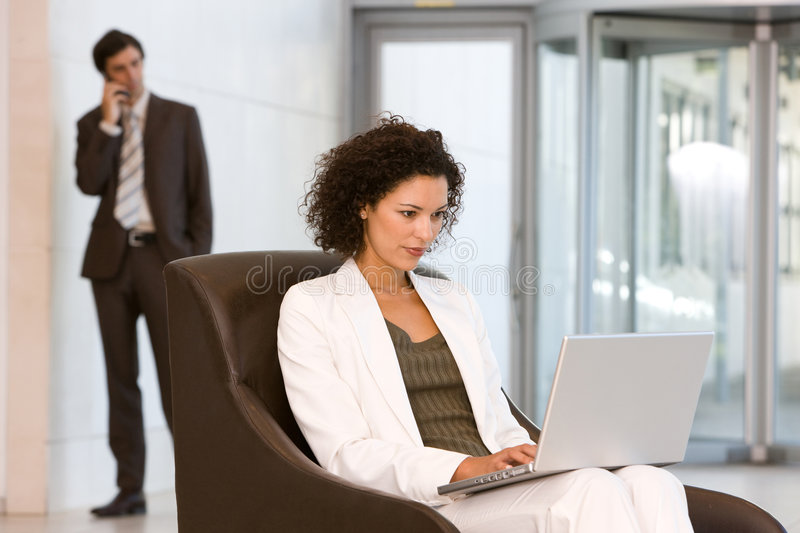 Attractive business woman working on laptop royalty free stock photos