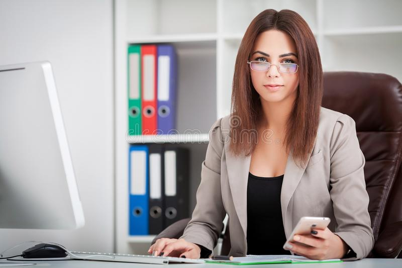 Attractive business woman working on laptop computer stock photography