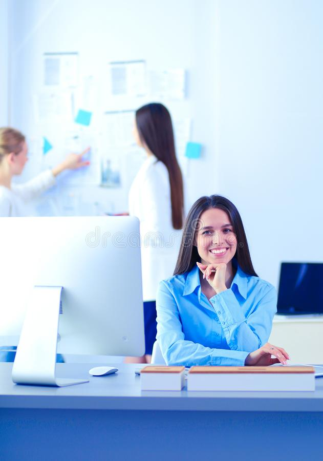 Attractive business woman working on laptop at office. Business people stock photos